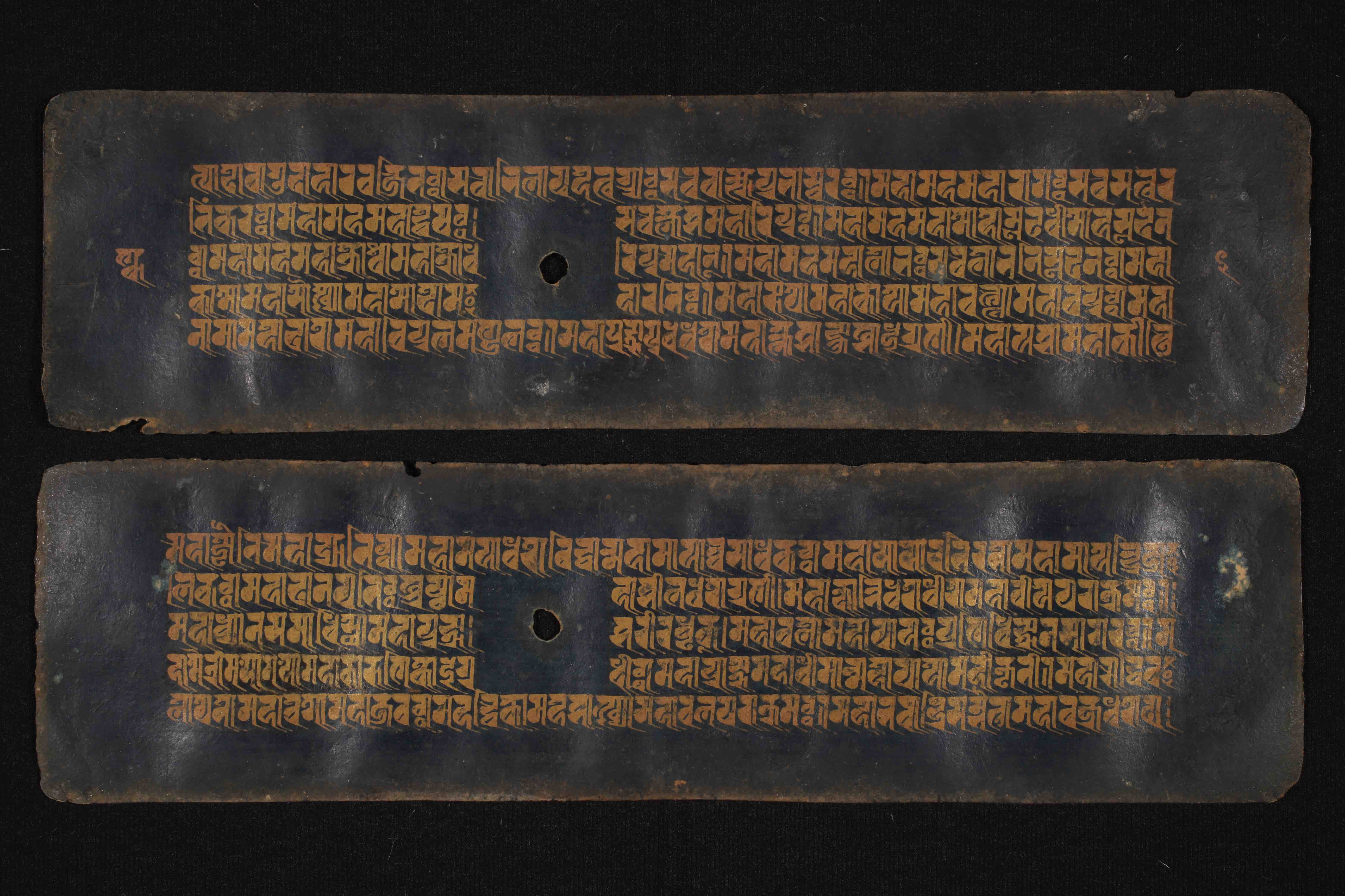 Buddhist manuscript from the Āśā Archives, Kathmandu, Nepal, containing the Nāmasaṃgīti, written with golden ink in Rañjanā script on Nīlapatra ('black paper'), dating approximately to the 17th c. (DPN 3922)
