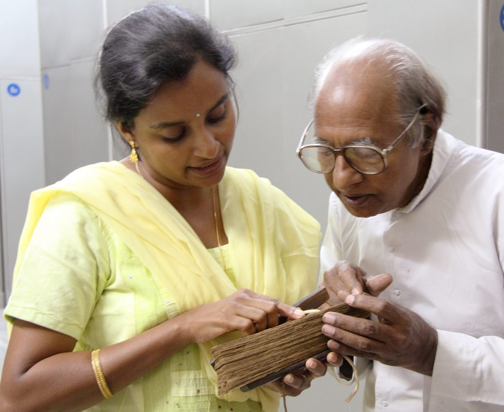 Scholar of Old Malayalam and Malayalam Garshuni, Fr. George Kurukkoor and historian Dr. Susan Thomas translate a bound, palm-leaf manuscript