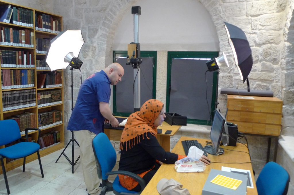 Sheima Budeiry at work digitizing her family's Islamic manuscript collection in Jerusalem
